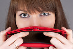 Purse at the mouth Royalty Free Stock Photography