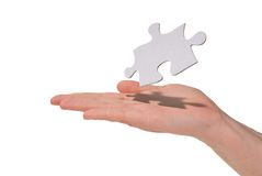 Woman holding an puzzle piece Stock Photos
