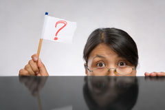 Woman holding question mark flag royalty free stock images
