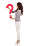 Woman holding question mark Royalty Free Stock Photos