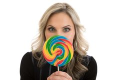 Woman Holding Rainbow Lollipop Royalty Free Stock Photography