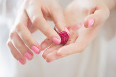 Woman holding raspberry in hands Stock Photo
