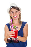 Woman holding a raspberry juice - isolated. Picture of a smiling young woman holding a refreshing raspberry juice with ice and mint, posing on isolated Stock Photo