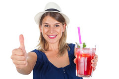 Woman holding a raspberry juice - isolated. Picture of a smiling young woman holding a refreshing raspberry juice with ice and mint, posing on isolated Royalty Free Stock Photo
