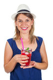 Woman holding a raspberry juice - isolated. Picture of a smiling young woman holding a refreshing raspberry juice with ice and mint, posing on isolated Stock Image