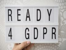 Woman holding a Ready for GDPR lightbox royalty free stock photos