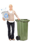 Woman holding a recycle bin Royalty Free Stock Photos