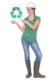 Woman holding recycle logo Stock Images