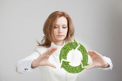 Woman holding recycle symbol in his hands Stock Image