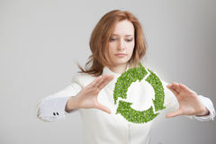 Woman holding recycle symbol in his hands Royalty Free Stock Photography
