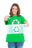 Woman holding recycling bin Stock Images