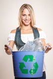 Woman holding a recycling bin Royalty Free Stock Photo