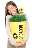 Woman holding recycling bin smiling royalty free stock photo