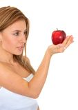 Woman holding a red apple Stock Image