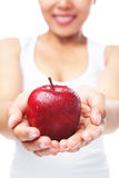 Woman holding a red apple Royalty Free Stock Images