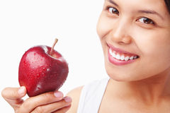 Woman holding red apple Royalty Free Stock Images
