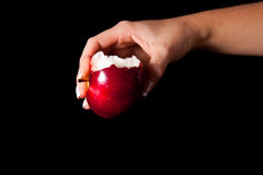 Woman holding red apple Stock Images