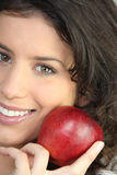 Woman holding a red apple Stock Photo