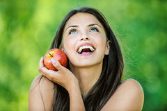 Woman holding an red apple Royalty Free Stock Photos