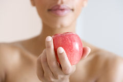 A woman holding a red apple Royalty Free Stock Photography