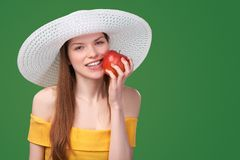 Woman holding red apple Royalty Free Stock Photography