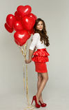 Woman holding red balloon Royalty Free Stock Image
