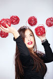 Woman holding red balls Stock Photos