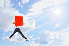 Woman holding red blank board jumping and sun sky Royalty Free Stock Photos