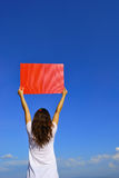 Woman holding red blank board jumping and sun sky Stock Photography