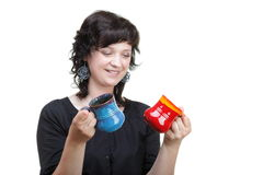 Woman holding a red and blue cup, isolated Royalty Free Stock Photos