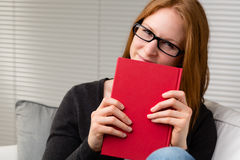 Woman Holding a Red Book Royalty Free Stock Photography