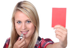 Woman holding a red card Royalty Free Stock Image