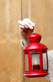Woman holding red christmas lantern Royalty Free Stock Images