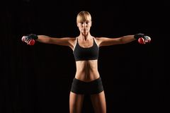 Woman Holding Red Dumbbells Stock Image