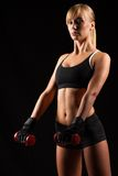 Woman Holding Red Dumbbells Stock Photo
