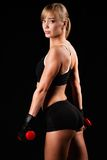 Woman holding red dumbbells Stock Images