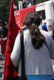 Woman holding red flag at a demonstration Royalty Free Stock Photos