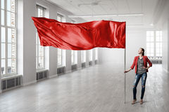 Woman holding red flag Royalty Free Stock Images