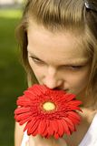Woman holding a red flower Royalty Free Stock Photography