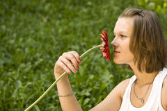 Woman holding a red flower Stock Image