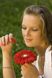 Woman holding a red flower Stock Photos