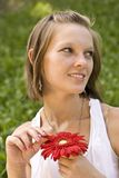 Woman holding a red flower Royalty Free Stock Image