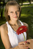 Woman holding a red flower Stock Photography