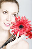 Woman holding red flowers Royalty Free Stock Photography