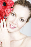 Woman holding red flowers Royalty Free Stock Photos