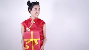 Woman holding red gift box in concept of happy chinese new year stock video footage
