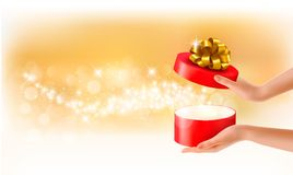 Woman holding a red gift box on holiday background Royalty Free Stock Photography