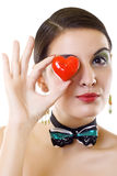 Woman holding a red heart Stock Images