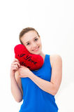 Woman holding a red heart Royalty Free Stock Images