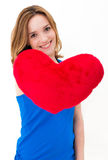 Woman holding a red heart Stock Photography
